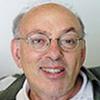Portrait photo en couleur de Henry Mintzberg, auteur et professeur en sciences de gestion