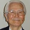 Portrait photo en couleur de Massaki Imai, théoricien de l'organisation et consultant en gestion
